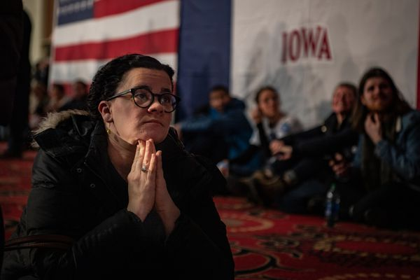 Mackenzie Mcilmail watches TV as she waits for results of the Iowa caucuses in Des Moines, on Monday, Feb. 3, 2020. MUST CREDIT: Washington Post photo by Salwan Georges