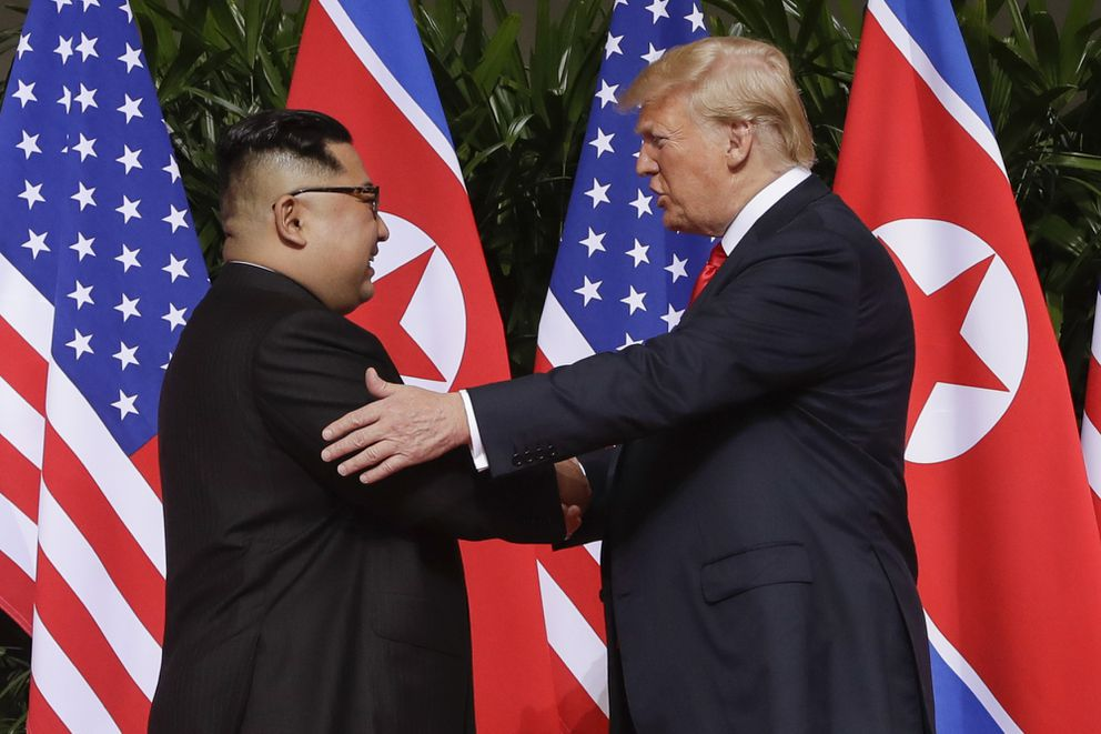 In this June 12, 2018, file photo, President Donald Trump, right, shakes hands with North Korea leader Kim Jong Un at the Capella resort on Sentosa Island in Singapore. (AP Photo/Evan Vucci, File)