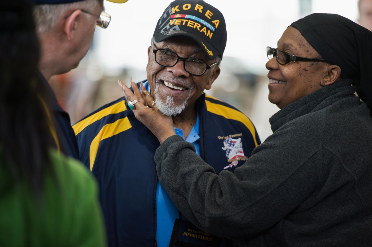 Joe Gibbons is greeted by friends and family before he departs with other veterans.  (Marc Lester / ADN)