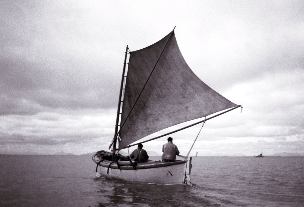 "Fishermen sail off Flounder Flats circa 1935. The letter ""A"" painted on the side of the boat at the stern indicates the boat is crewed by fishermen who are residents of Alaska. For a period of time canneries distinguished resident fishermen from non-resident fishermen because privileges like higher prices, better sailboats or delivery preferences were extended to non-resident fishermen. Often this discrimination was required by the fisherman's union in the labor contract with a cannery. Most fishermen were not residents of Alaska. (Dave and Mary Carlson collection / Sam Fox Museum)"