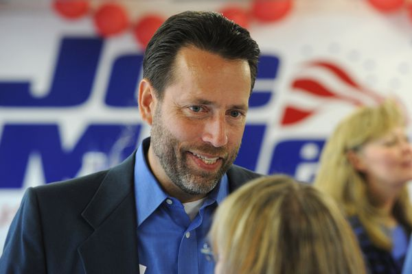 U.S. Senate candidate Joe Miller speaks with supporters after the polls closed on Aug. 19, 2014. (Bill Roth / Alaska Dispatch News)
