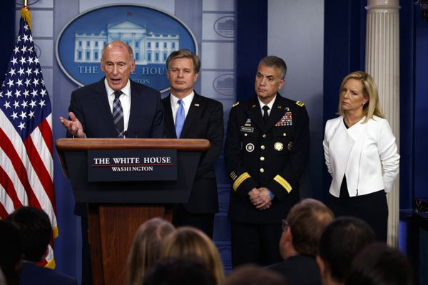 Director of National Intelligence Dan Coats speaks during the daily press briefing at the White House, Thursday, Aug. 2, 2018, in Washington, as FBI Director Christopher Wray, National Security Agency Director Gen. Paul Nakasone, and Secretary of Homeland Security Kirstjen Nielsen listen. The White House says President Donald Trump has directed a