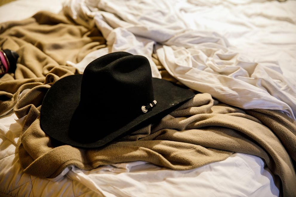 Adrian Murfitt's beloved cowboy hat, on a hotel room bed in Las Vegas, two days after he died in Brian MacKinnon's arms. (Marcus Yam/Los Angeles Times/TNS)