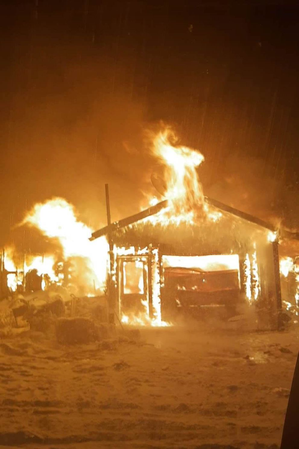 Lauren McIver-O'Hara's house burns on Friday, Dec. 18, 2020 in Big Lake. McIver-O'Hara and her family lost all their possessions and 17 pets. (Courtesy Lauren McIver-O'Hara)