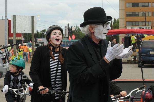 Melissa Jabaay reacts as Brian Hutton leads a mime skills training session before the mime bike tour of Spearnd in Anchorage, Alaska on Saturday, July 29, 2017. MimeSpenard teamed up with Spenard Bike Nation to tour the highlights of the Spenard neighborhood of Anchorage. (Bob Hallinen / Alaska Dispatch News)