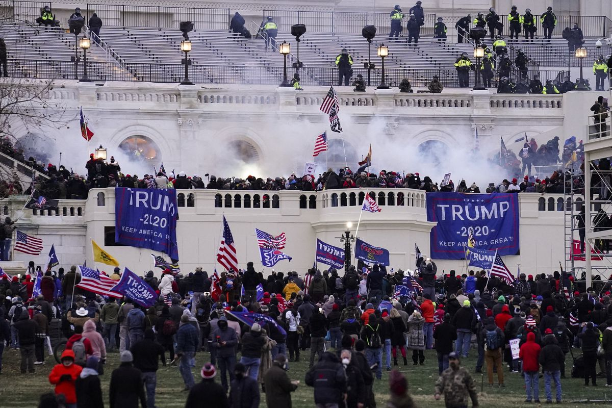 Violent protesters, loyal to President Donald Trump, storm the Capitol, Wednesday, Jan. 6, 2021, in Washington. (AP Photo/John Minchillo)
