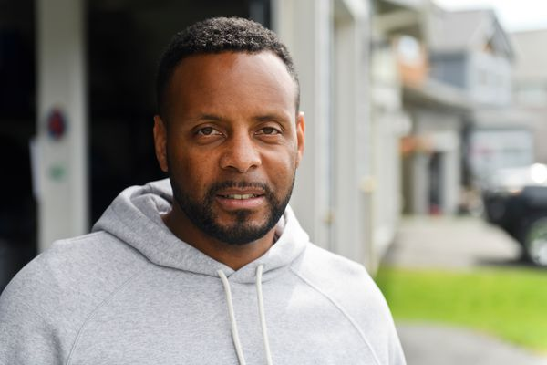 Anchorage resident DeWayne Ingram said he was recently stopped and questioned by a driver while he was jogging on a residential street. (Marc Lester / ADN)
