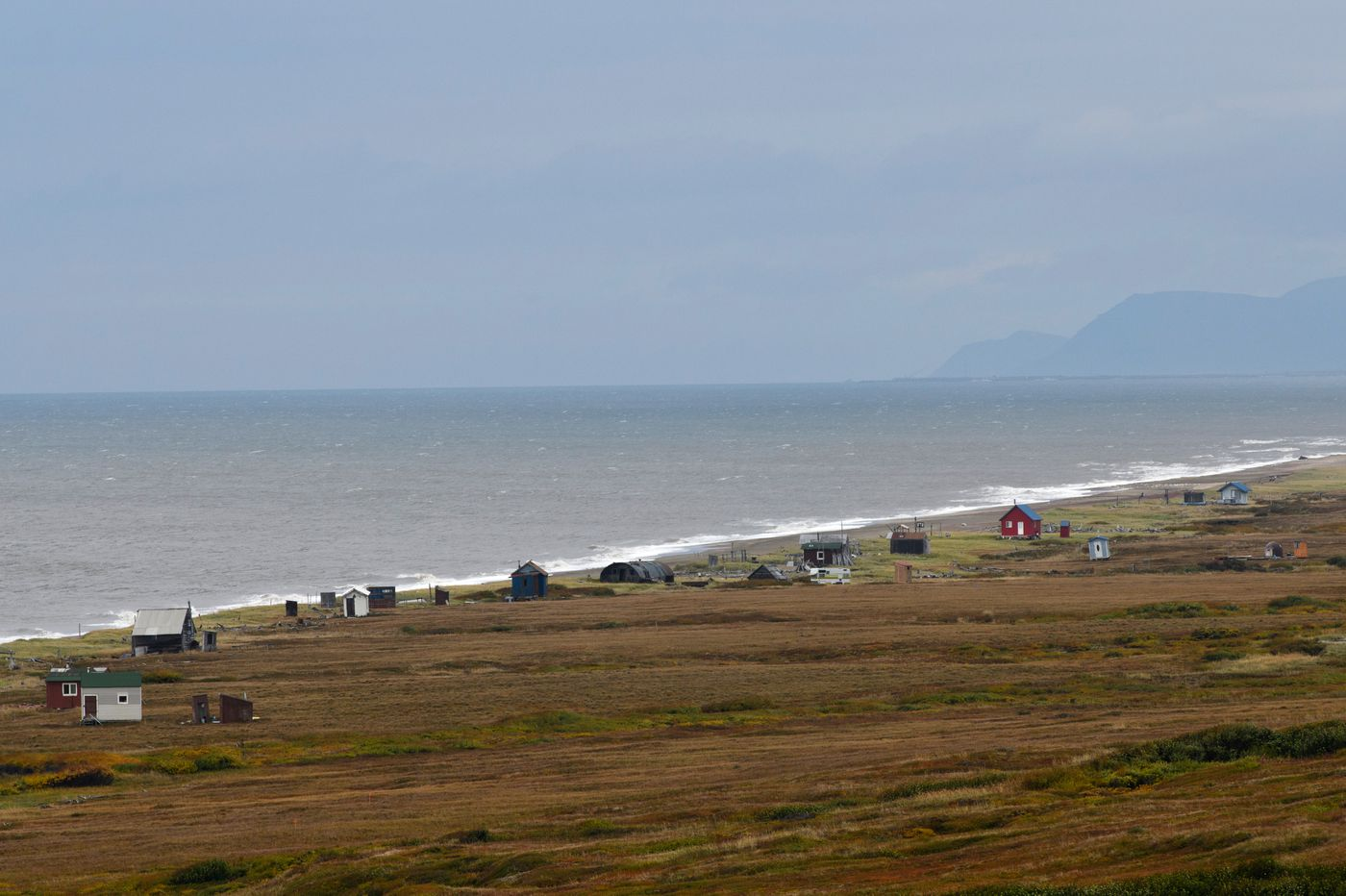 Cabins line the shore in a view from Cape Nome. (Marc Lester / ADN)