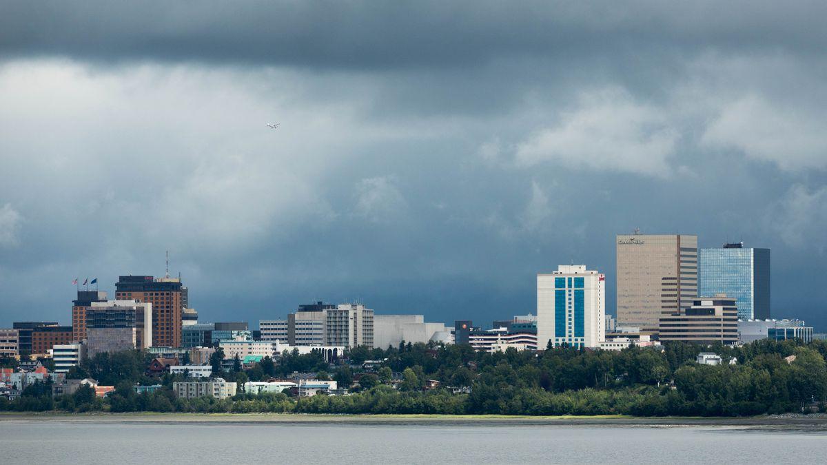A plane flies over downtown Anchorage Wednesday, Aug. 8, 2018. (Loren Holmes / ADN)