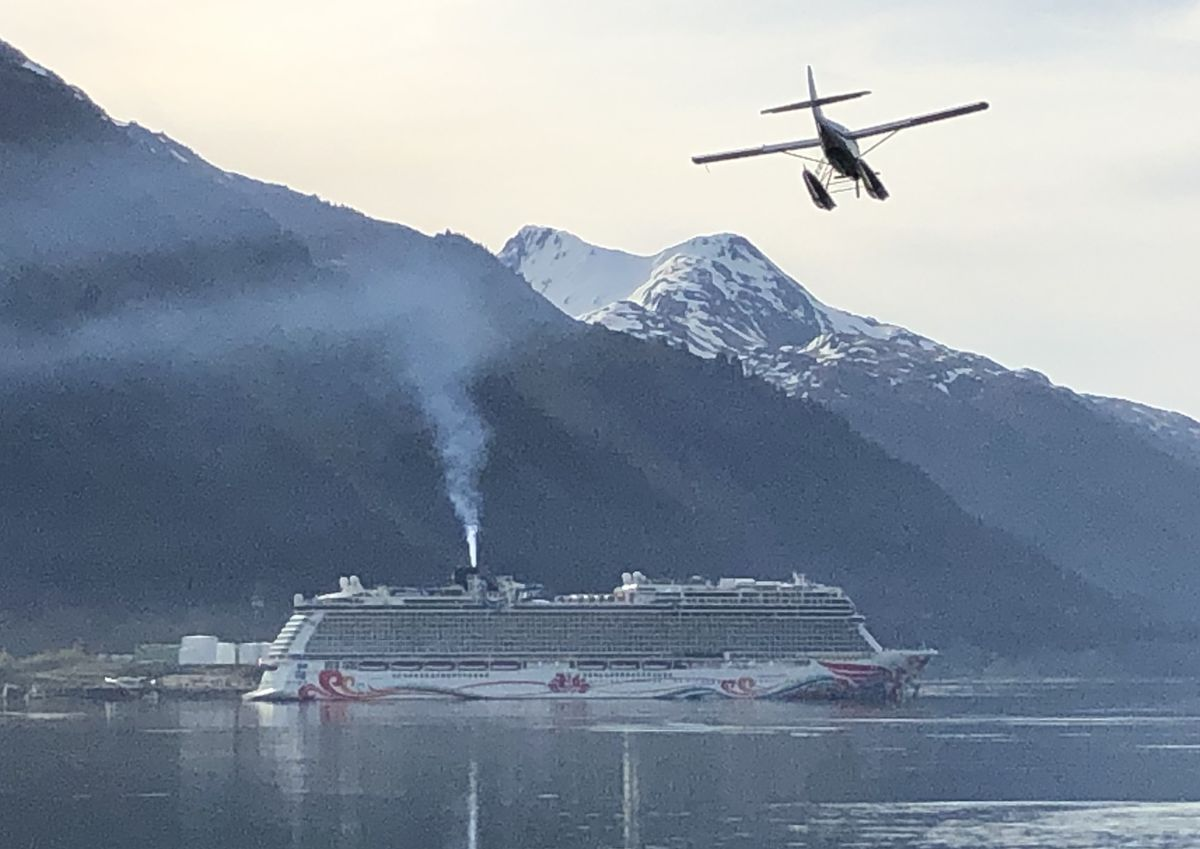 A floatplane prepares to land in the Port of Juneau Tuesday, May 14, 2019 as a Norwegian Cruise Lines ship is moored at the AJ dock. (James Brooks / ADN)