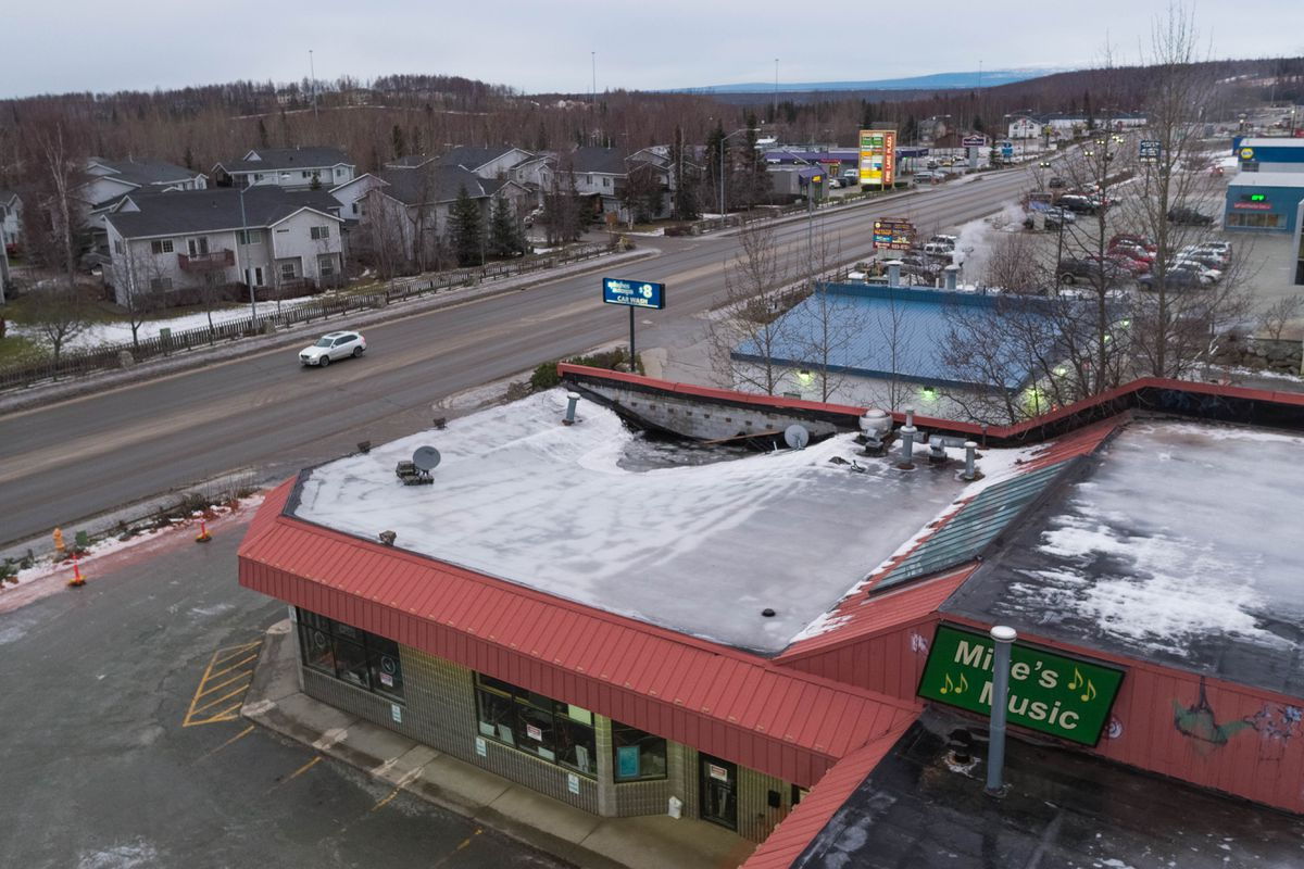 The roof of the Eagle River Pawn Shop, seen on Wednesday, Dec. 5, 2018, collapsed in an aftershock Monday night, according to owner Glen Keller. Prior to that he had been planning on re-opening after Friday's magnitude 7.0 earthquake. (Loren Holmes / ADN)
