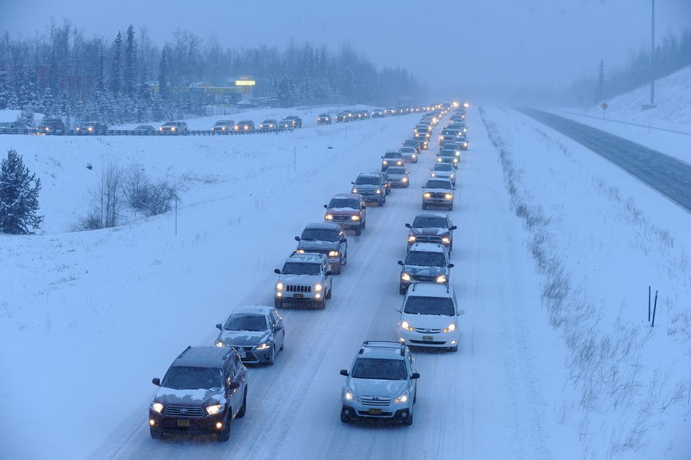 Traffic creeps along amid blowing snow on the northbound Glenn Highway near Eagle River on Thursday. (Bob Hallinen / ADN)