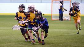 Lacrosse means sticks, balls and lots of running for kids