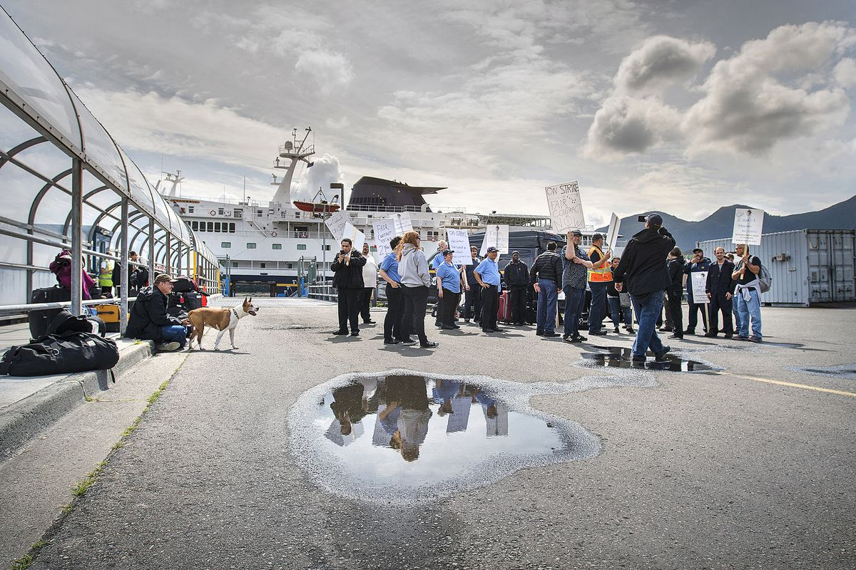 Some of the crew from the Alaska Marine Highway System ferry Columbia assemble for an Inlandboatmen's Union of the Pacific strike after failing to reach agreement on a contract with the state of Alaska, Wednesday, July 24, 2019, in Ketchikan, Alaska. (Dustin Safranek/Ketchikan Daily News via AP)