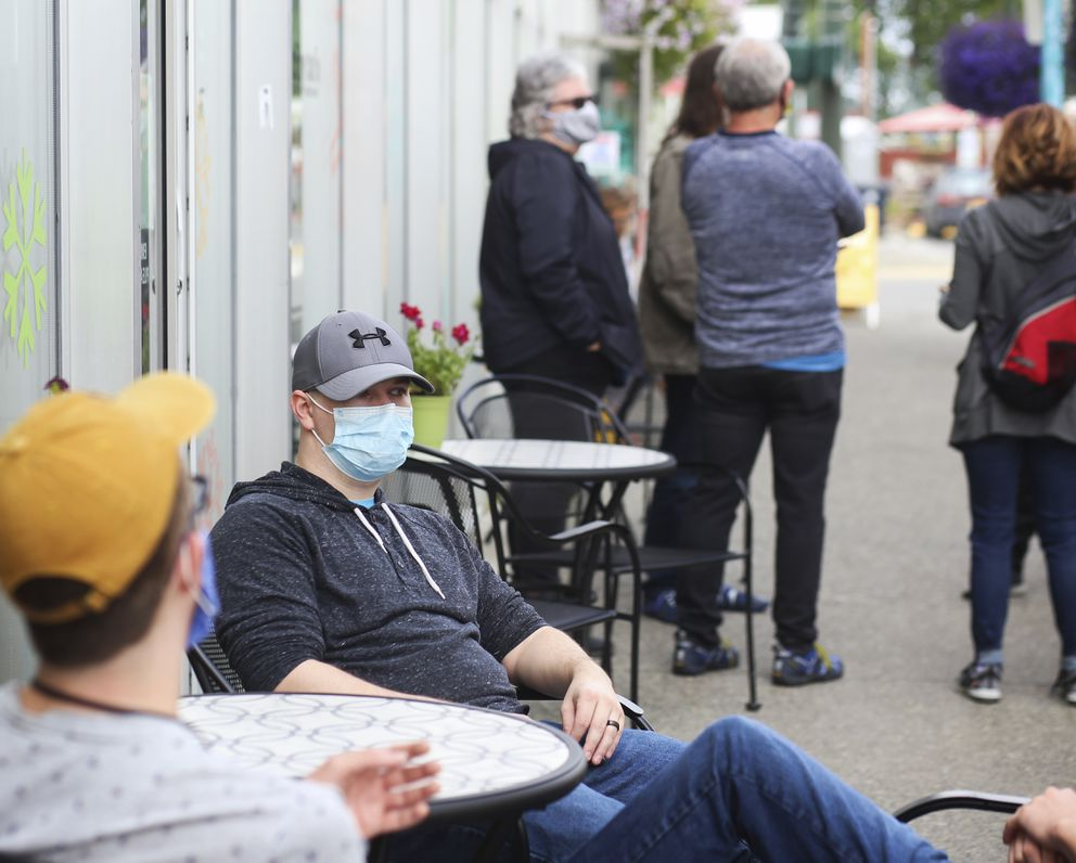 People gather and sit outside Snow City Cafe in Anchorage during the lunch rush on July 31, 2020. (Emily Mesner / ADN)