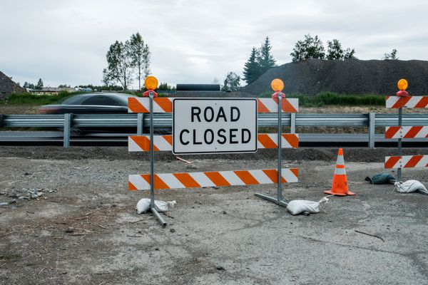 Construction on the frontage road restricts access to various buildings along Brayton Drive between Dimond Boulevard and Dowling Road on Wednesday June 29, 2017. To gain access to these businesses, one must use the residential roads to the east of the highway. (Young Kim / Alaska Disptach News)
