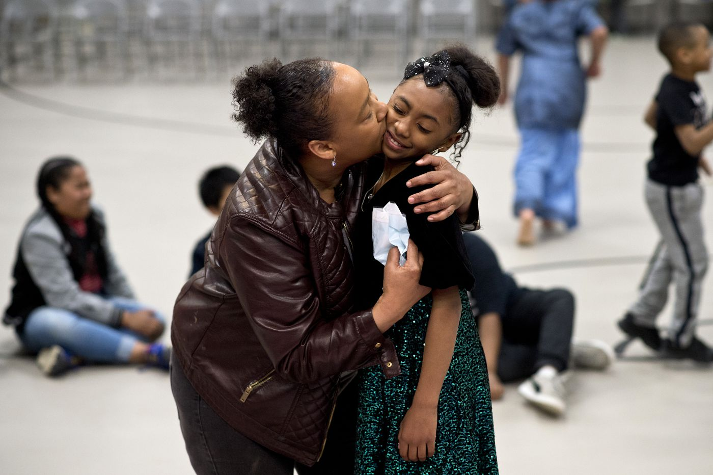 Keira Hall, 9, gets a smooch from her godmother, Princess Parson. (Marc Lester / ADN)