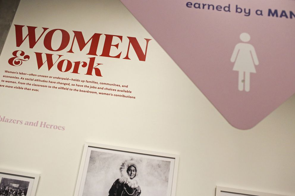 Signs and statistics show viewers the gender pay gap in front of another installation on 'Women & Work. ' Photographed on Nov. 10, 2020. (Emily Mesner / ADN)