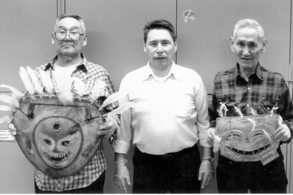 Yup'ik elders Wassillie Evan, left, Andy Paukan, center, and Willie Beans, right, display traditional masks at the Sheldon Jackson Museum in Sitka. (Tim Troll photo)