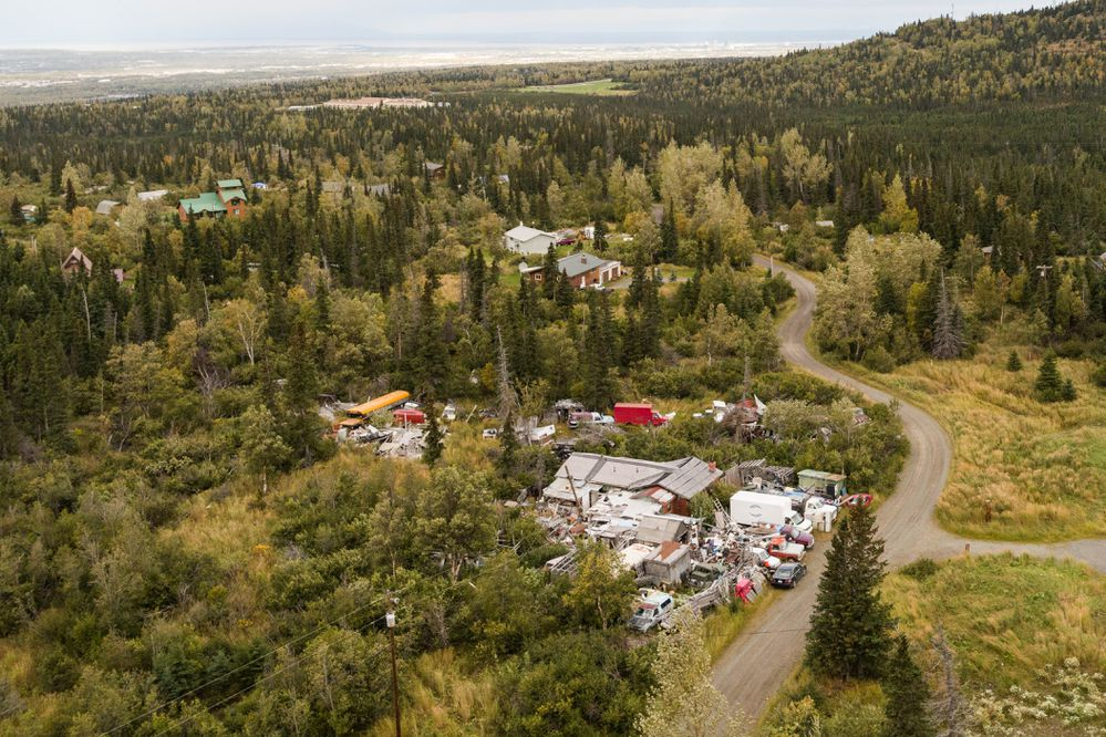 David and Jane Szabo's property in Bear Valley, photographed Wednesday, Sept. 13, 2017. The property, which is zoned R-6 for low-density residential, continues to be illegally operated as a junkyard seven years after superior court ordered the Szabos to pay $311,000 in fines to the city for failing to remove junk from their property. The Szabos appealed the superior court ruling to the Alaska Supreme Court, which affirmed the lower court ruling in March 2014. (Loren Holmes / Alaska Dispatch News)