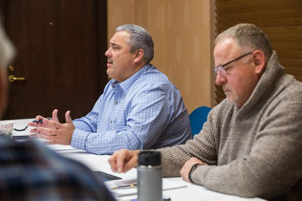 Iditarod CEO Stan Hooley (right) next to Iditarod Board president Andy Baker at a 2016 meeting. (Loren Holmes / Alaska Dispatch News)