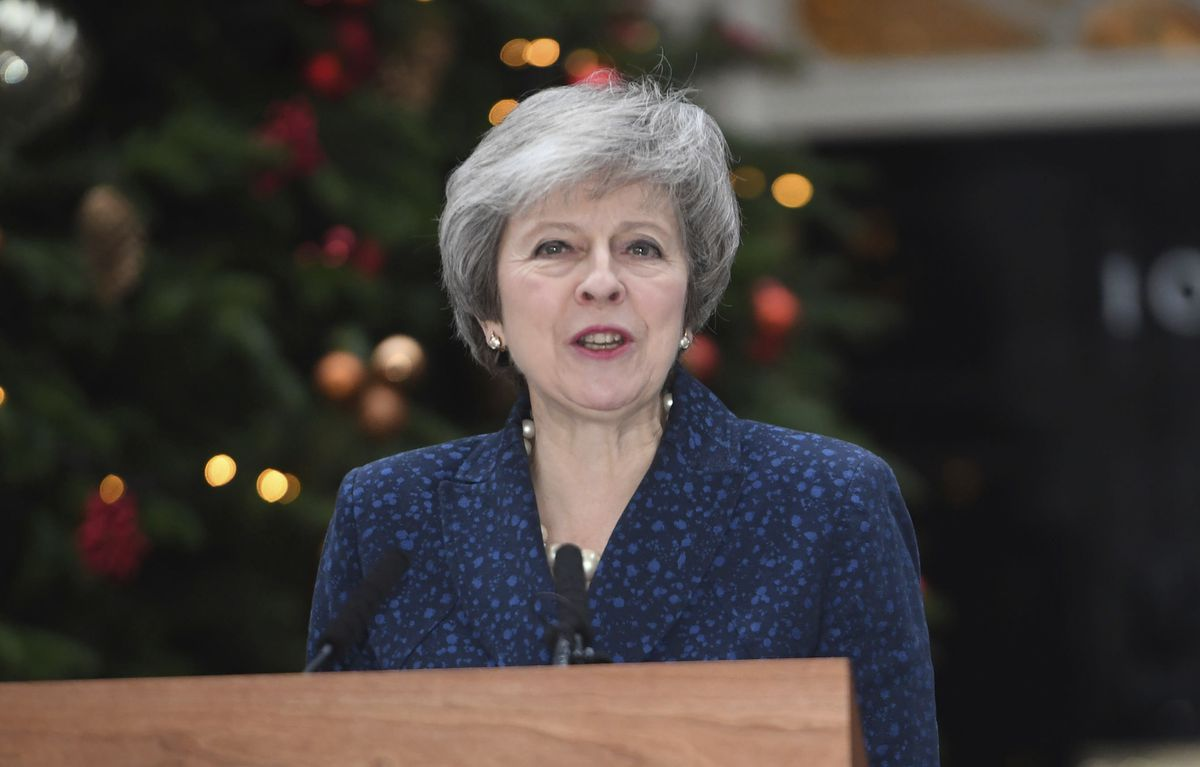 Britain's Prime Minister Theresa May makes a media statement in Downing Street, London, confirming there would be a vote of confidence in her leadership of the Conservative Party, Wednesday Dec. 12, 2018. (Stefan Rousseau/PA via AP)