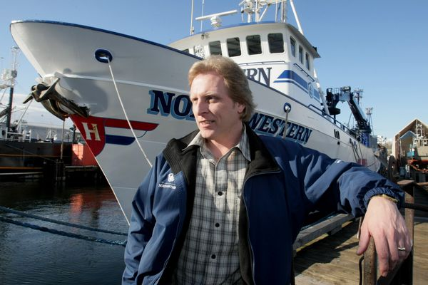 Sig Hansen poses for portrait with his boat the Northwestern docked at Ballard in Seattle, Washington, March 3, 2010. Hansen is coming out with a book about his upbringing in Ballard and life as a fisherman. He is famous because he and his boat are featured on Discovery Channel's