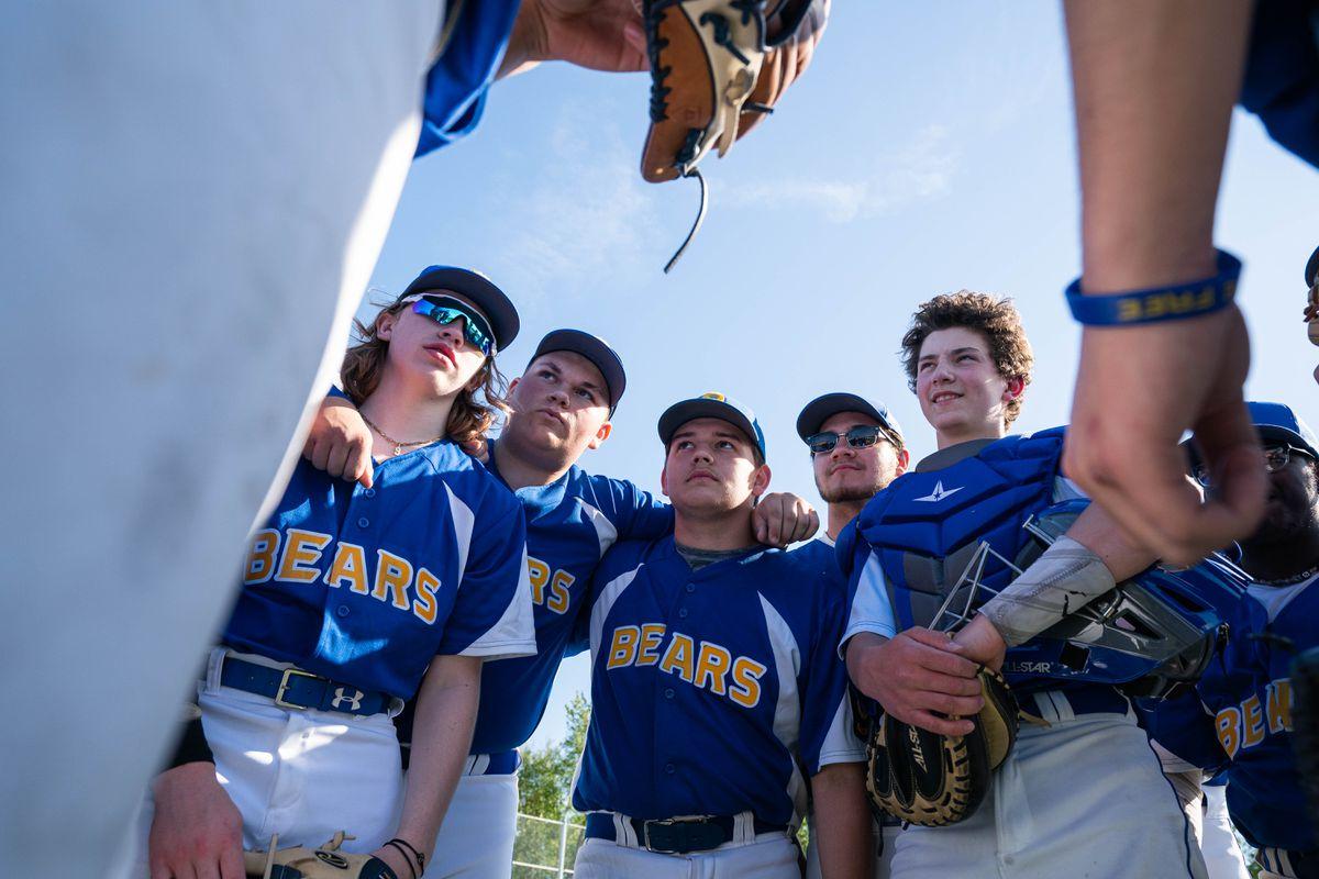 Bartlett High baseball players huddle before a game against Dimond on Friday. (Loren Holmes / ADN)