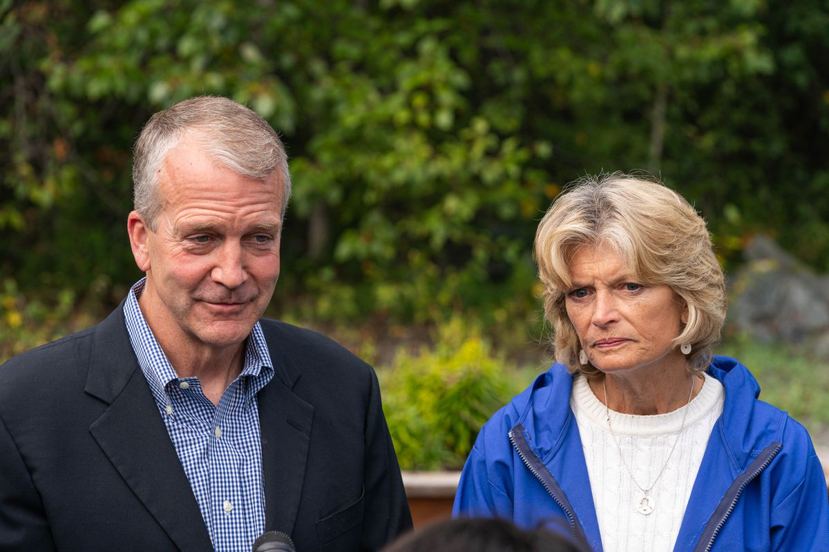 Sen. Dan Sullivan, R-Alaska, and Sen. Lisa Murkowski, R-Alaska, speak with a reporter after an event celebrating the opening of an Indian Affairs Cold Case Office on Wednesday, Aug. 26, 2020 at the Alaska Native Heritage Center in Anchorage. (Loren Holmes / ADN)
