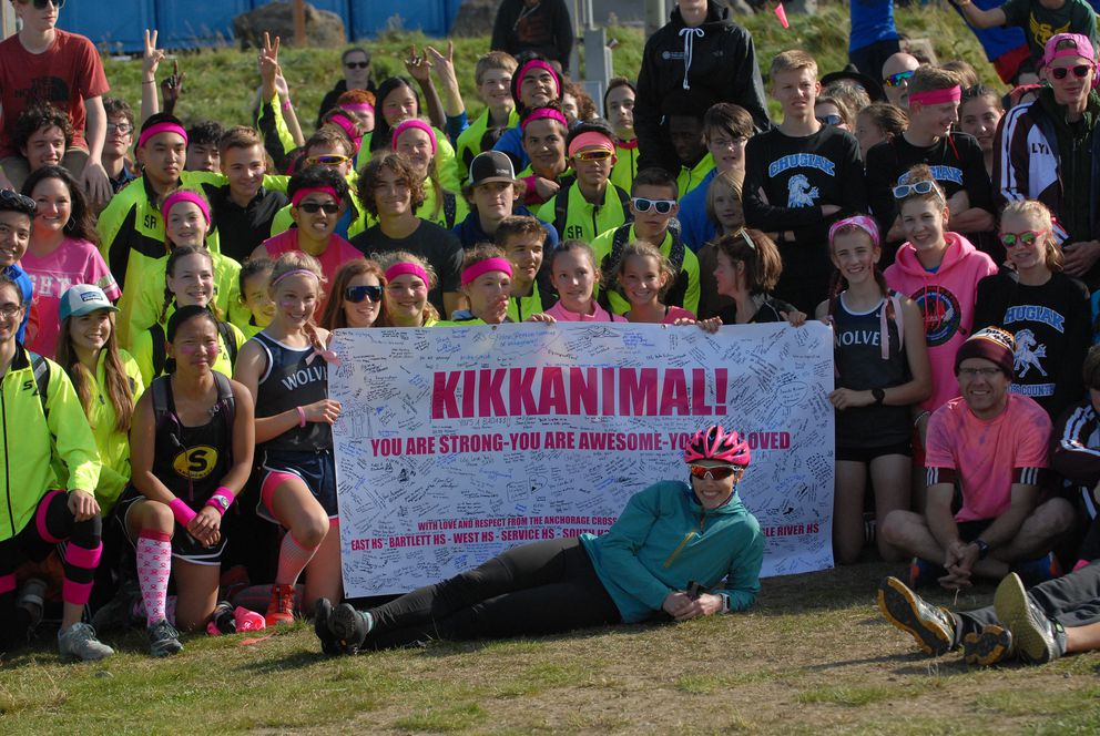 Kikkan Randall poses for a photo with athletes following the Big 8 XC Classic on Saturday at Kincaid Park. (Matt Tunseth / ADN)