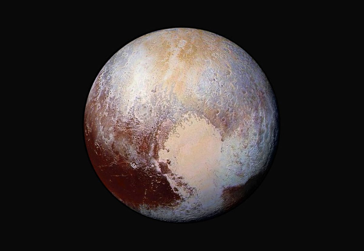 An exaggerated color photo shows the varied terrain of Pluto, the most well-known dwarf planet. (NASA / JHUAPL / SwRI)