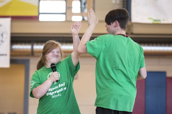 Ali Shuttleworth and Seth Knuckey high-five each other during a lip sync competition at Camp Shriver Alaska Thursday, July 20, 2017, at the Special Olympics Alaska Sports, Health and Wellness Center in Anchorage. Camp Shriver Alaska is a two-week summer sports camp for middle and high-school-aged students with and without intellectual disabilities. (Rugile Kaladyte / Alaska Dispatch News)
