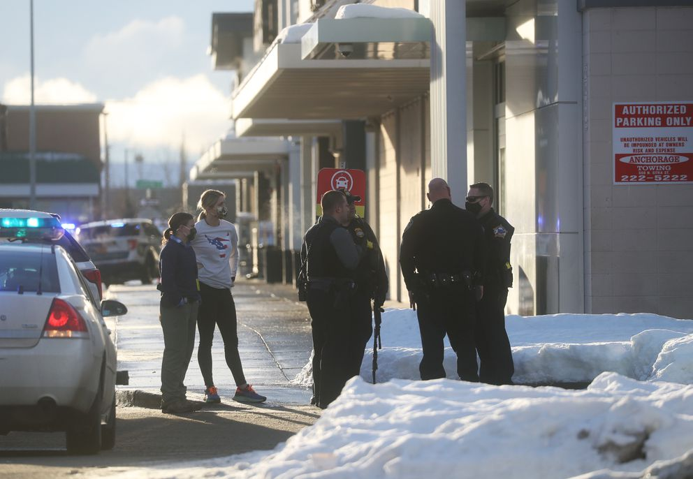 Anchorage Police Officers respond to a scene at the Midtown Mall in Anchorage on Monday, Jan. 11, 2021. (Emily Mesner / ADN)