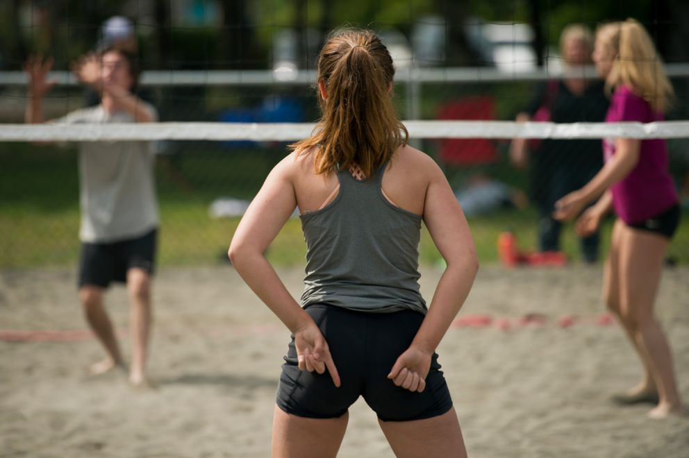 Hope Todd signals to her teammate during a Pass To Play AK beach volleyball tournament. (Marc Lester / Alaska Dispatch News)