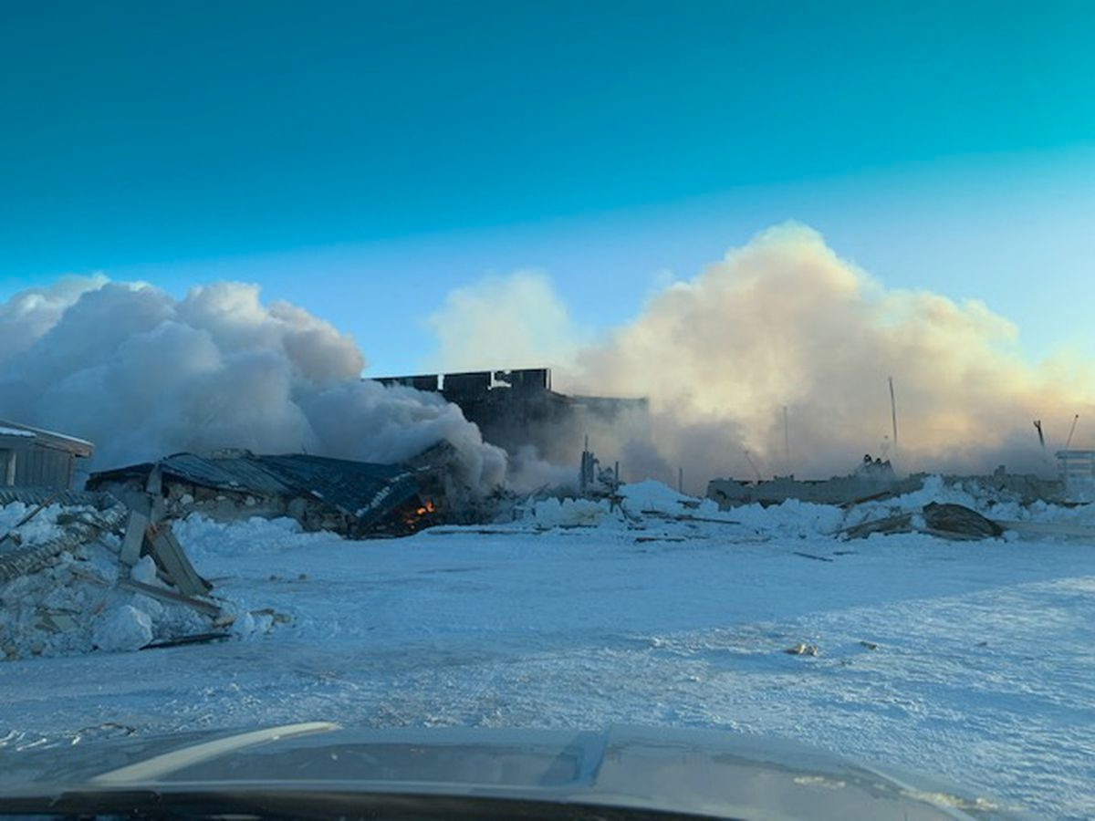 Smoke billows from the Kaktovik's Harold Kaveolook School Friday, Feb. 7, 2020. First responders were called to the building around 3 a.m. but cold weather hampered efforts to extinguish the blaze. (Photo courtesy from Amanda Kaleak)