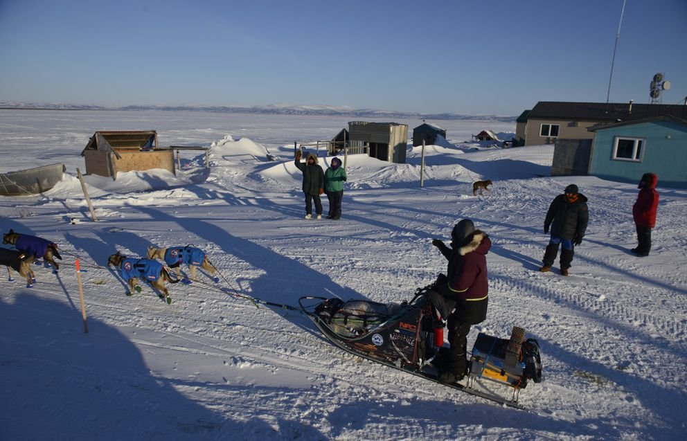 Noah Burmeister waves to people in Shaktoolik before he pulls out of town during the 2016 Iditarod. (Marc Lester / ADN archive)