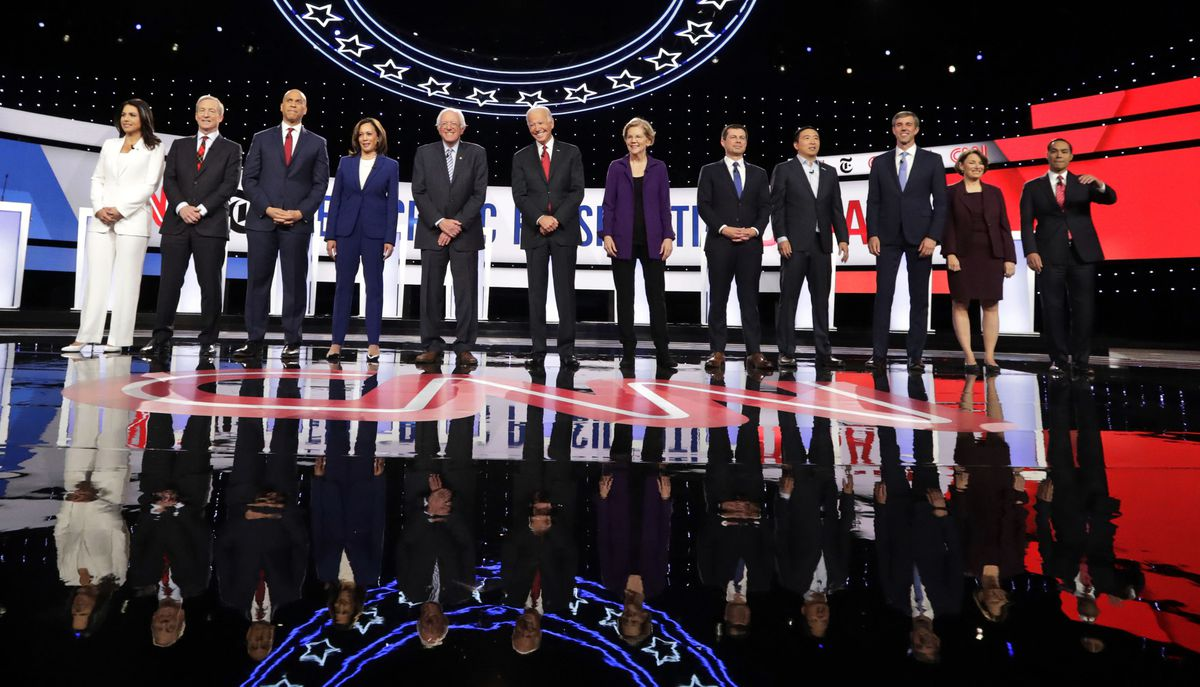 From left, Democratic presidential candidates, Rep. Tulsi Gabbard, D-Hawaii, businessman Tom Steyer, Sen. Cory Booker, D-N.J., Sen. Kamala Harris, D-Calif., Sen. Bernie Sanders, I-Vt., former Vice President Joe Biden, Sen. Elizabeth Warren, D-Mass., South Bend Mayor Pete Buttigieg, entrepreneur Andrew Yang, former Texas Rep. Beto O'Rourke, Sen. Amy Klobuchar, D-Minn., and former Housing Secretary Julian Castro stand on stage for a photo before a Democratic presidential primary debate hosted by CNN and The New York Times at Otterbein University, Tuesday, Oct. 15, 2019, in Westerville, Ohio. (AP Photo/Tony Dejak)