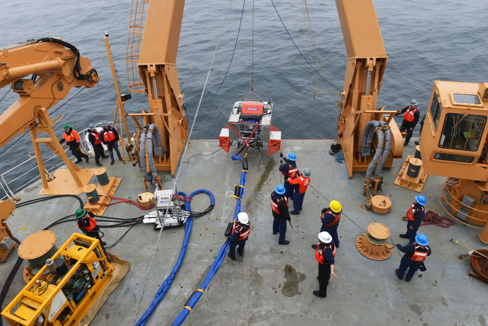 The RotoX oil skimmer is hoisted onto the Coast Guard Cutter Healy after a test in the Bering Sea northwest of St. George inJuly. (Senior Chief Petty Officer Rachel Polish / U.S. Coast Guard)