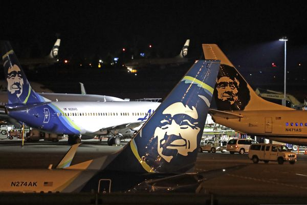 FILE - In this Friday, Aug. 10, 2018, file photo, Alaska Airlines planes sit on the tarmac at Sea-Tac International Airport in SeaTac, Wash. Officials say an Alaska Airlines jetliner struck a brown bear while landing early Saturday evening, Nov. 14, 2020, killing the animal and causing damage to the plane. (AP Photo/Elaine Thompson, File)