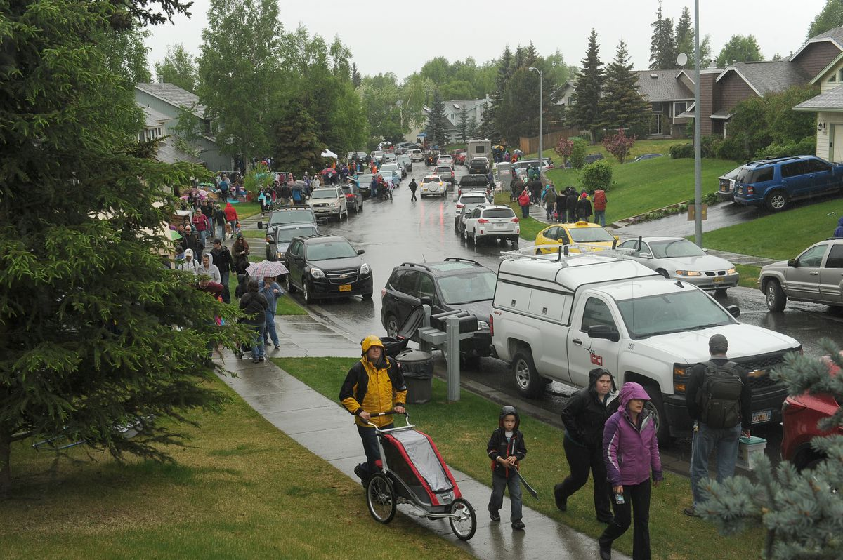 People of all ages and backgrounds scour the Kempton Hills neighborhood for bargains during the annual neighborhood garage sale on Saturday, May 21, 2016. The huge event filled the neighborhood with people and cars. (Bob Hallinen / ADN)