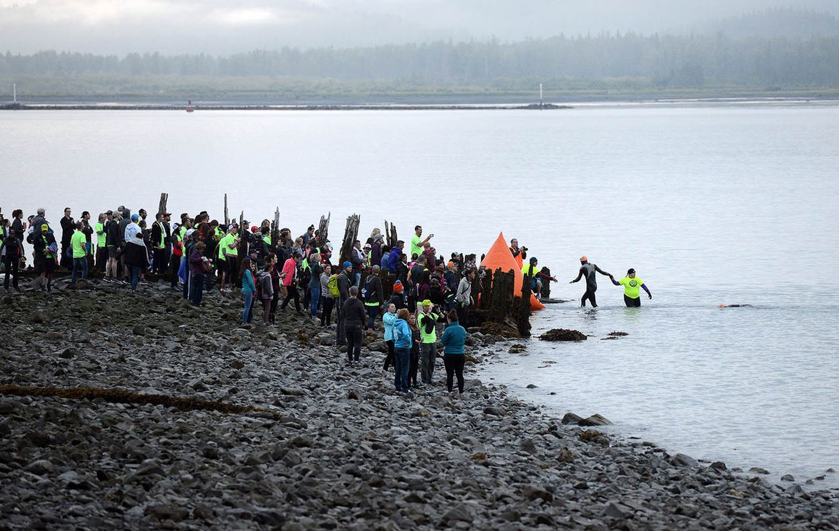 Swimmers emerge from Resurrection Bay during Saturday's Alaskaman Extreme Triathlon. (Photo by Erik Hill)