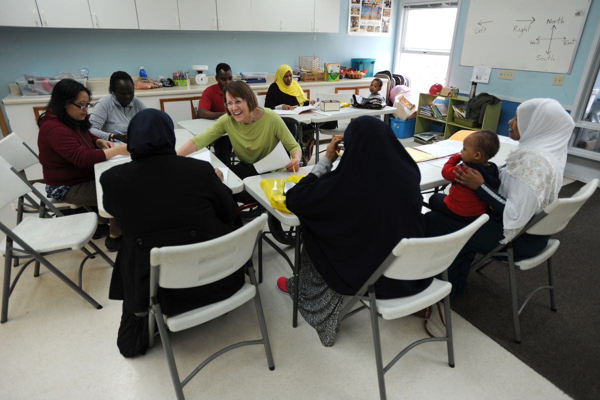 Retired teacher Cindy Johnson, center, teaches a citizenship class for refugees through the Catholic Social Services on Tuesday. (Bill Roth / ADN)