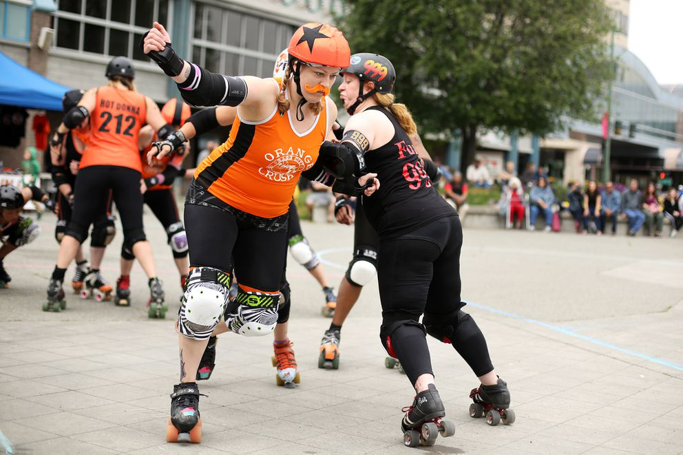 Jammer Stephanie Neill aka AK CupQuake attempts to skate past blockers. The Rage City Rollergirls held the Roller Derby Solstice Scrimmage on Saturday June 20, 2015 with a mashup of players from the Orange Crush and All Star teams.