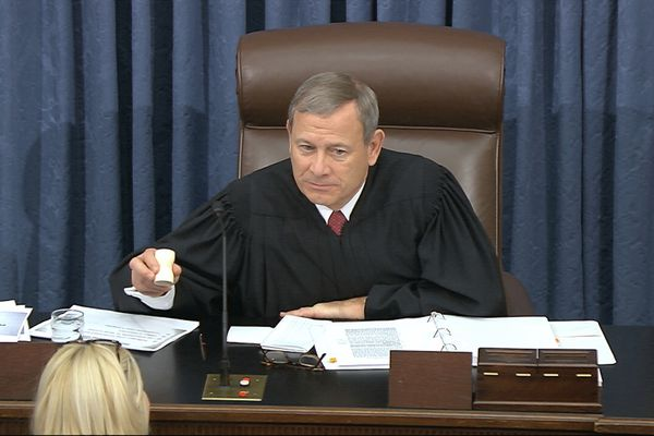 In this image from video, presiding officer Supreme Court Chief Justice John Roberts gables the day to a close during the impeachment trial against President Donald Trump in the Senate at the U.S. Capitol in Washington, Friday, Jan. 24, 2020. (Senate Television via AP)