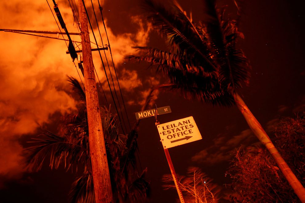 Lava illuminates a sign in Leilani Estates during ongoing eruptions of the Kilauea Volcano in Hawaii, U.S., June 9, 2018. REUTERS/Terray Sylvester TPX IMAGES OF THE DAY