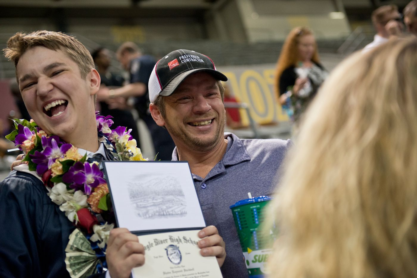 Shawn Stockwell, left, laughs with his father, George, after receiving his high school diploma. (Marc Lester / Alaska Dispatch News)