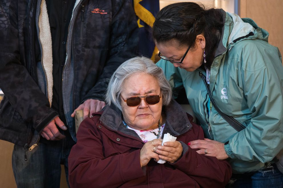 Olga Tinker-John comforts her aunt Elena Sergie as Alaska State Troopers announce the arrest of Steven H. Downs in the 1993 Fairbanks murder of Sophie Sergie, on Friday at the Alaska State Crime Lab. Elena Sergie is Sophie's mother. (Loren Holmes / ADN)