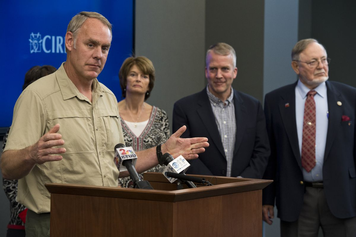 Interior Secretary Ryan Zinke answers questions following a meeting with the Alaska Federation of Natives and Alaska's congressional delegation in Anchorage on Tuesday. Sen. Lisa Murkowski, Sen. Dan Sullivan and Rep. Don Young listen at right. (Marc Lester / Alaska Dispatch News)