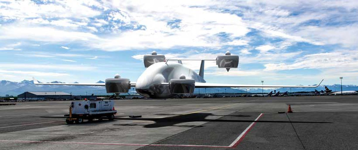 With a 60-foot wingspan, the Wyvern, seen here in an artist's concept at Ted Stevens Anchorage International Airport, is Sabrewing's largest unmanned aerial vehicle now in development. With manufacturing planned for Anchorage, its 4,400-pound payload, 1,600-mile range and 22,000-foot ceiling are comparable to a Cessna Caravan, but with the ability to take off and land vertically. (Rendering courtesy Sabrewing Aircraft Co. Inc.)