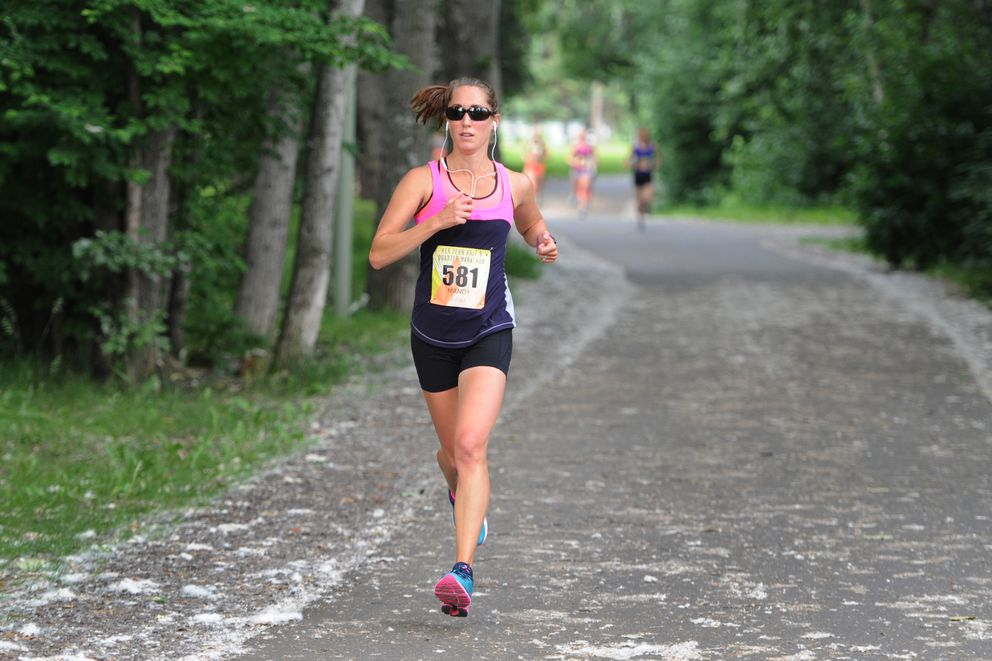Mandy Vincent-Lang runs along the Chester Creek trail en route to winning Sunday's Her Tern Half Marathon. (Bill Roth / Alaska Dispatch News)